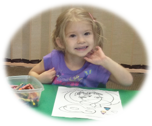 Three-year-olds work on coloring and other artwork to help develop fine motor skills.  (Hope you have a big door on your refrigerator.)